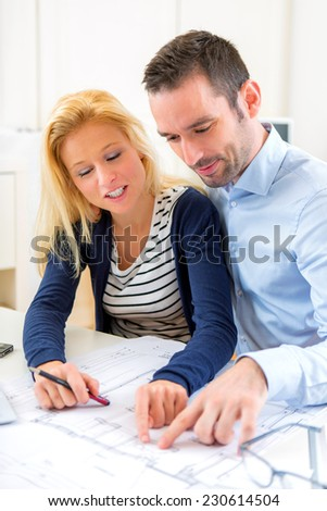 View of a Young couple studying plans of their future house