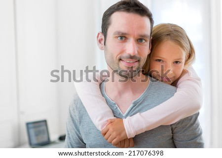 View of a Young girl hugging his father