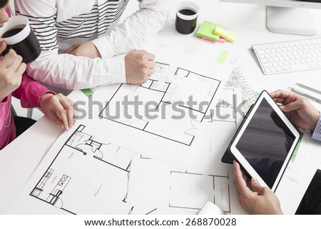 View of a young relaxed couple meeting a real estate agent - stock photo