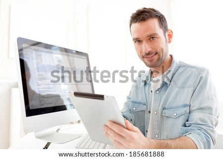 View of a Young relaxed man using tablet at home  - stock photo