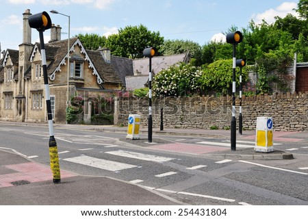 View of a Zebra Pedestrian Crossing in a Typical English Town - stock photo