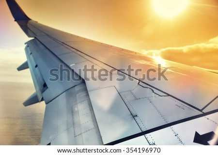 View of airplane wing through the window. Travel concept