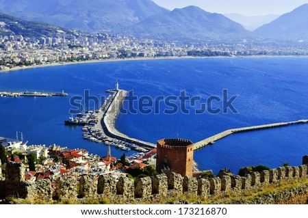 View of Alanya harbor from Alanya peninsula. Turkish Riviera - stock photo