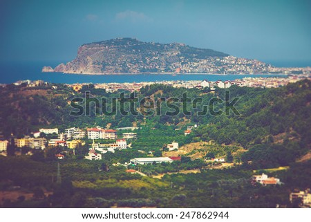 View of Alanya peninsula, green slopes mountain and sea coast. Turkey.  Filtered image:cross processed lomo effect.  - stock photo