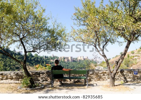 View of Alhambra and Granada from Sacromonte with a man - stock photo