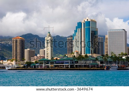 View of Aloha Tower and Aloha Market place on the harbor - stock photo