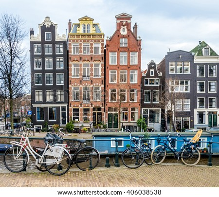 View of Amsterdam canal with  typical Dutch houses.  - stock photo