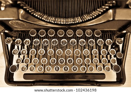 View of an antique manual Underwood typewriter on sepia - stock photo