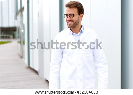 View of an attractive doctor in front of a hospital