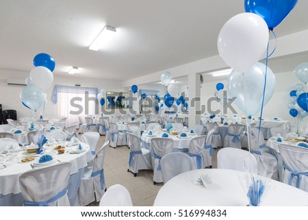 View of an empty blue boyl baptism celebration.