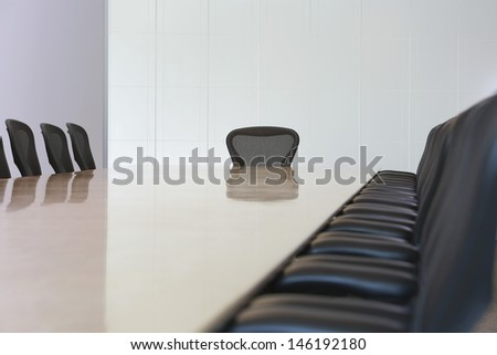 View of an empty boardroom with seats - stock photo