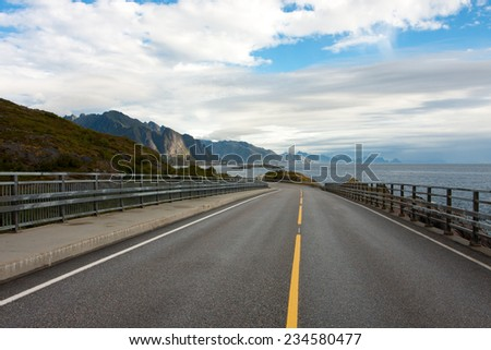 view of an empty winding road at the Lofoten islands