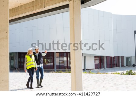 VIew of an Engineer and Architect checking last details on a construction site