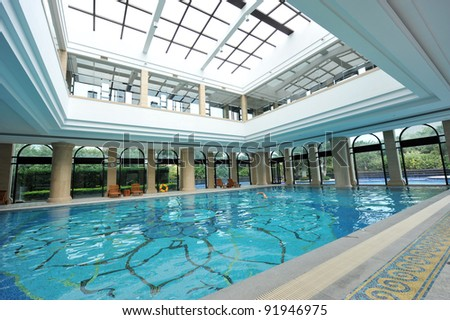 view of an indoor pool at a hotel