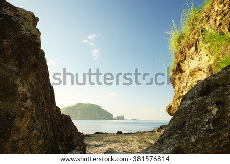 View of an Island taken over two big rock of Tanjung Aan in Lombok.