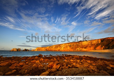 View of an ocean coastline during sunset at Pointe de Toulinguet in Brittany, France