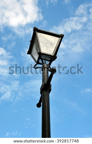 View of an Old Fashioned Antique Street Light again a Blue Sky on a London Street - stock photo