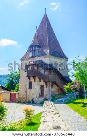 view of an old guarding tower of the citadel in the romanian city sighisoara - stock photo