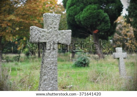 View of an Old Stone Cross in a Graveyard - stock photo