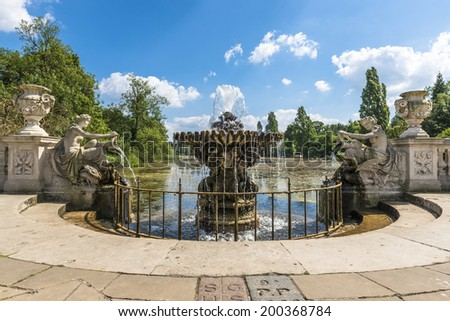 View of an old stone fountain with flowing water in Hyde Park, London, UK - stock photo