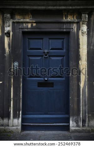 View of an Old Weathered House Front Door - stock photo