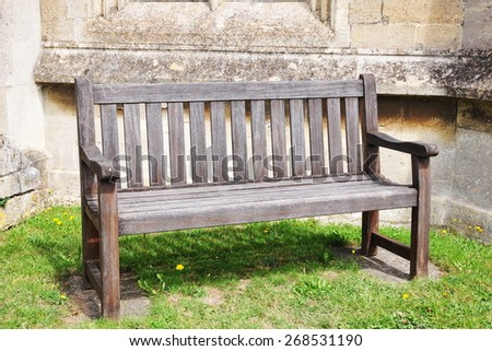 View of an Old Wooden Bench in a Park - stock photo