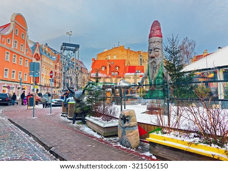 View of an open-air Leisure Park EGLE based in the Old Town of Riga right next to Riga Town Hall. Christmas in Latvia, Europe. - stock photo