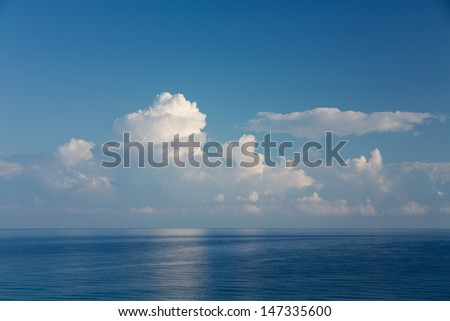 View of an open sea with a cloud