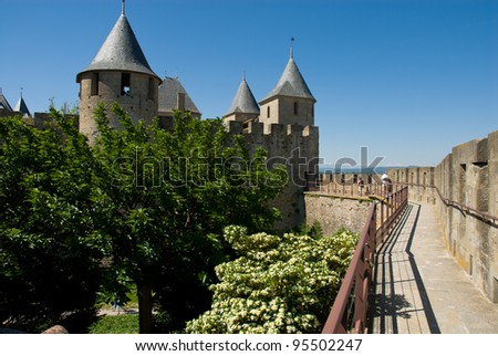 View of Ancient chateau and rampart in Carcassonne Chateau. Carcassone is a fortified chateau in France. It was added to the UNESCO list of World Heritage Sites in 1997. - stock photo