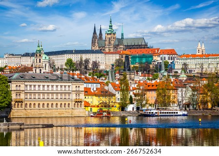 View of and Gradchany (Prague Castle) and St. Vitus Cathedral over  Vltava river - stock photo