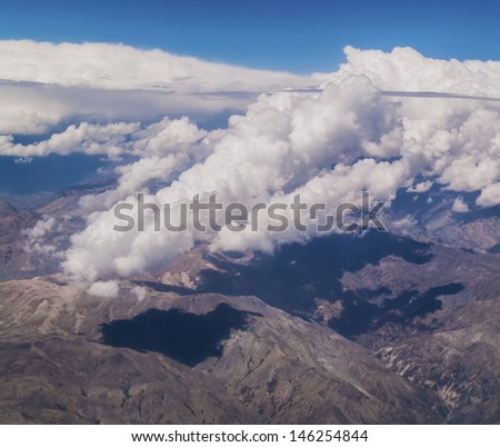 View of Andes Mountains form a plane. Border between Chile and Argentina. - stock photo