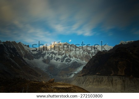 View of Annapurna I from Annapurna Base Camp Himalaya Mountains in Nepal at sunrise - stock photo