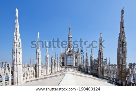 View of architectural detail of Milano Duomo Cathedral roofs, Milan Italy - stock photo