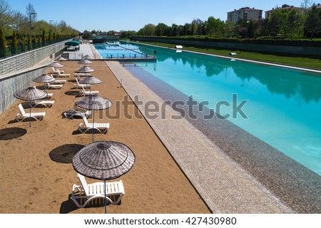 View of artificial coast made along Porsuk River in Eskisehir on bright blue sky background. - stock photo