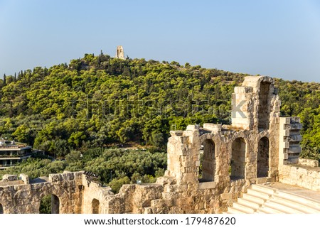 View of Athens and The Odeon of Herodes Atticus. The Odeon of Herodes Atticus is a stone theatre near  of the Acropolis of Athens. It was built in 161 AD by the Athenian magnate Herodes Atticus
