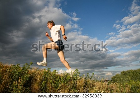 View of athlete jumping on the background of sky