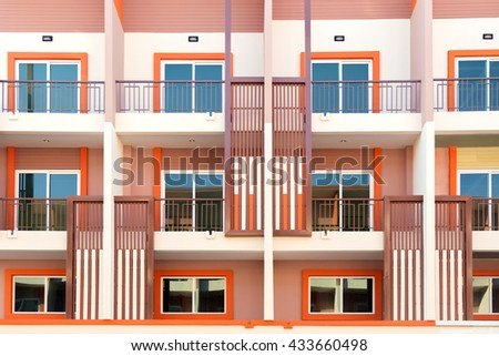 View of balconies of apartment building in construction site. - stock photo