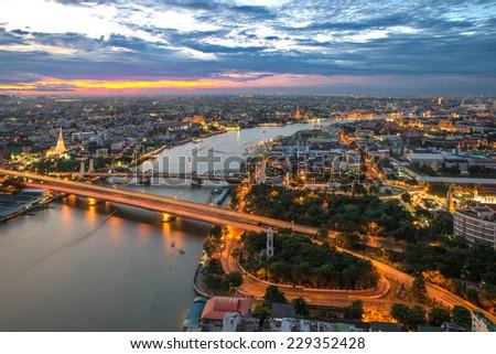 View of Bangkok city along Chao phraya River - stock photo