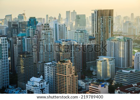 View of Bangkok skyline in the evening. This picture was taken at the commercial center of Bangkok, Thailand. - stock photo