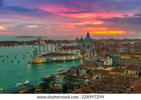 View of Basilica di Santa Maria della Salute at night under very dramatic sunset,Venice, Italy - stock photo