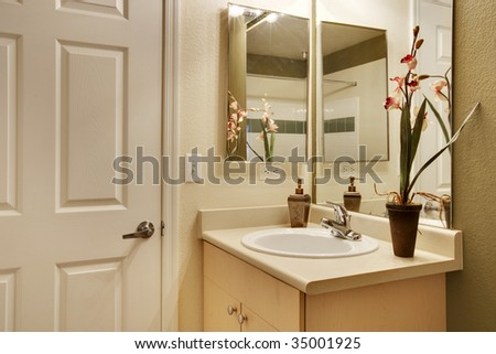 View of bathroom sink and door - stock photo
