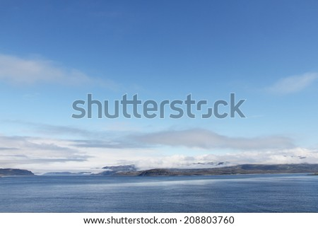 View of bay, blouds and mountains in northern Norway - stock photo