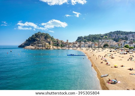 View of beach and castle in Tossa de Mar, Costa Brava, Spain. - stock photo
