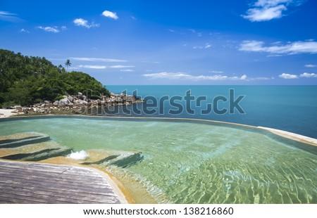 view of beach and gulf of thailand from luxury hotel infinity swimming pool in lamai ko samui - stock photo