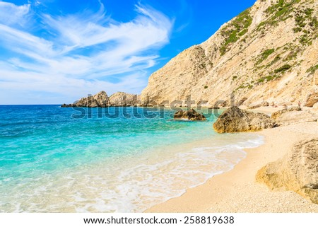 View of beautiful beach with rocky cliffs at Mediterranean Sea - stock photo