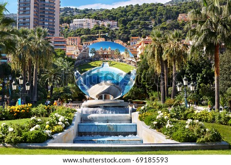 View of beautiful fountain and reflected building of Monte Carlo Grand Casino. Monaco - stock photo