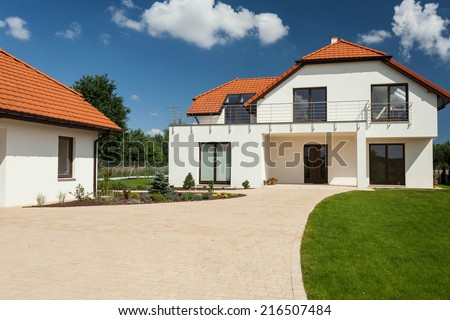 View of beautiful modern house with separate garage - stock photo