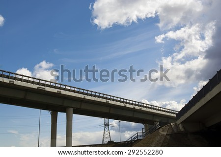 View of beautiful road and bridge, blue sky