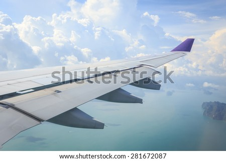 View of beautiful sea and cloud with wing of airplane from window