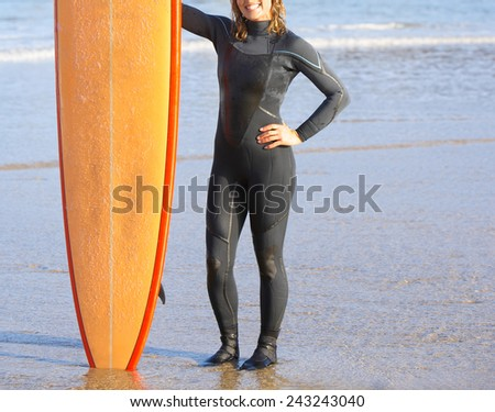 view of beautiful sexy young woman surfer girl in bikini - stock photo